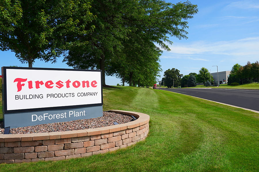 Photo of Firestone Sign and professional landscaping