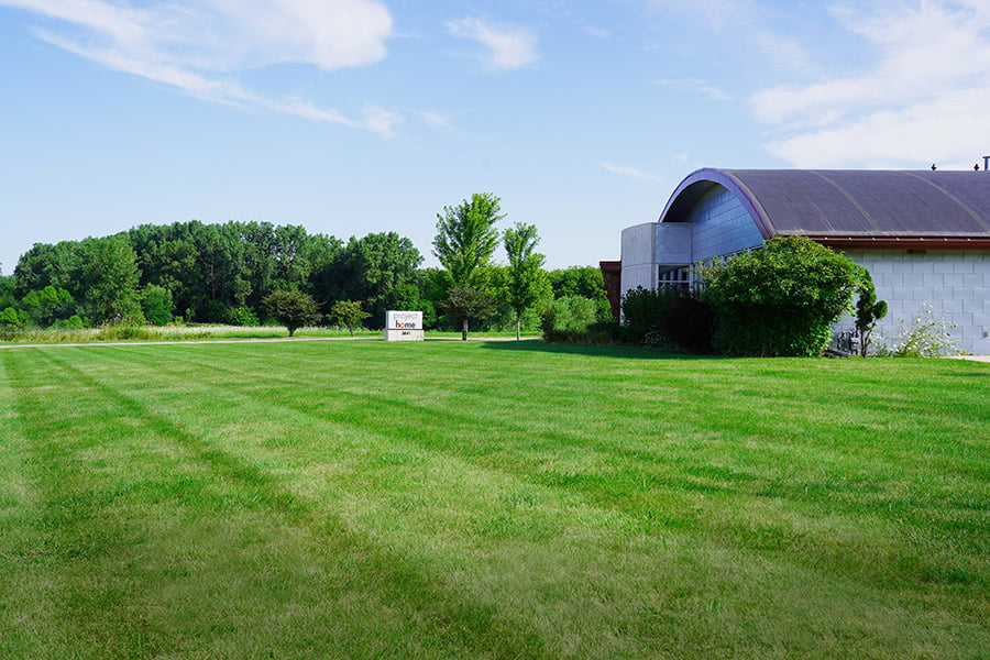Photo of lawn stripes in front of Project Home