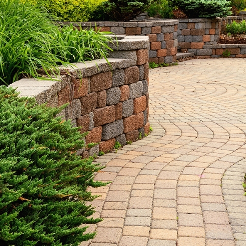Image of block retaining wall and brick pavers