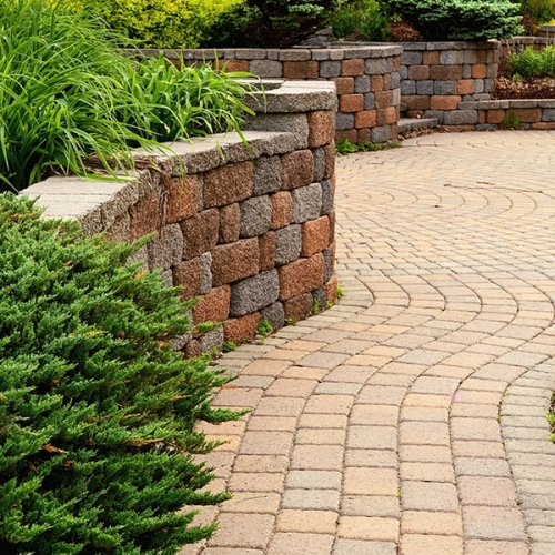 Image of block retaining wall and brick pavers