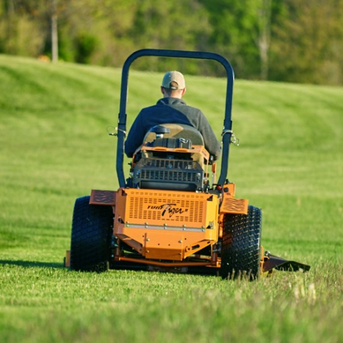 man mowing lawn with scag mower